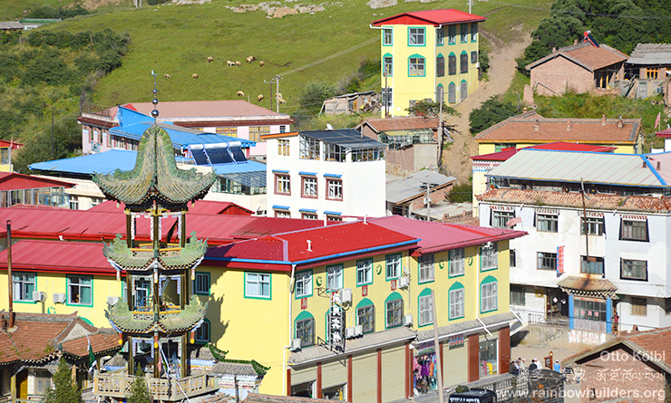 The Moslem Hui minority, recognizable here with the mosque in the foreground and their yellow and green houses, are a good example of a tightly knit community which has done very well in business.